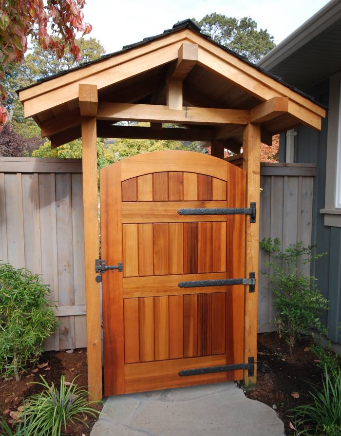 Awesome Wood Gate With Dark Bronze Strap Hinges