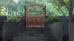 The gate is the entryway to the pool area. Beautiful stone stairway leading you into a garden paradise! Featuring: Modern Ring Latch with Rectangular Ring.