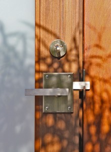 The Contemporary Alta Stainless Steel Gate Latch with round deadbolt on Gate built by Mike Bless at Lido Gates in Huntington Beach