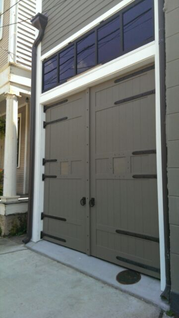 Painted carriage house doors after the historic homes committee required a change from exposed wood