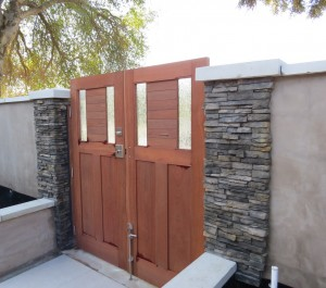 Sapele double entry gate with cane bolt and electronic strike