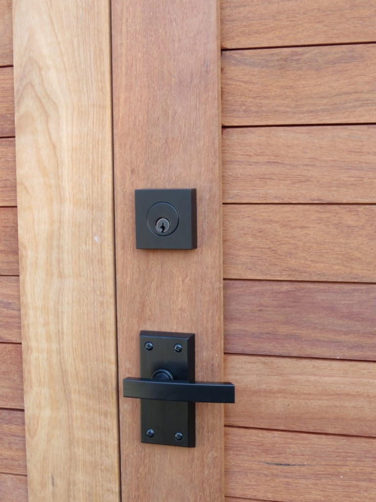 black contemporary lever gate latch on sapele wood gate