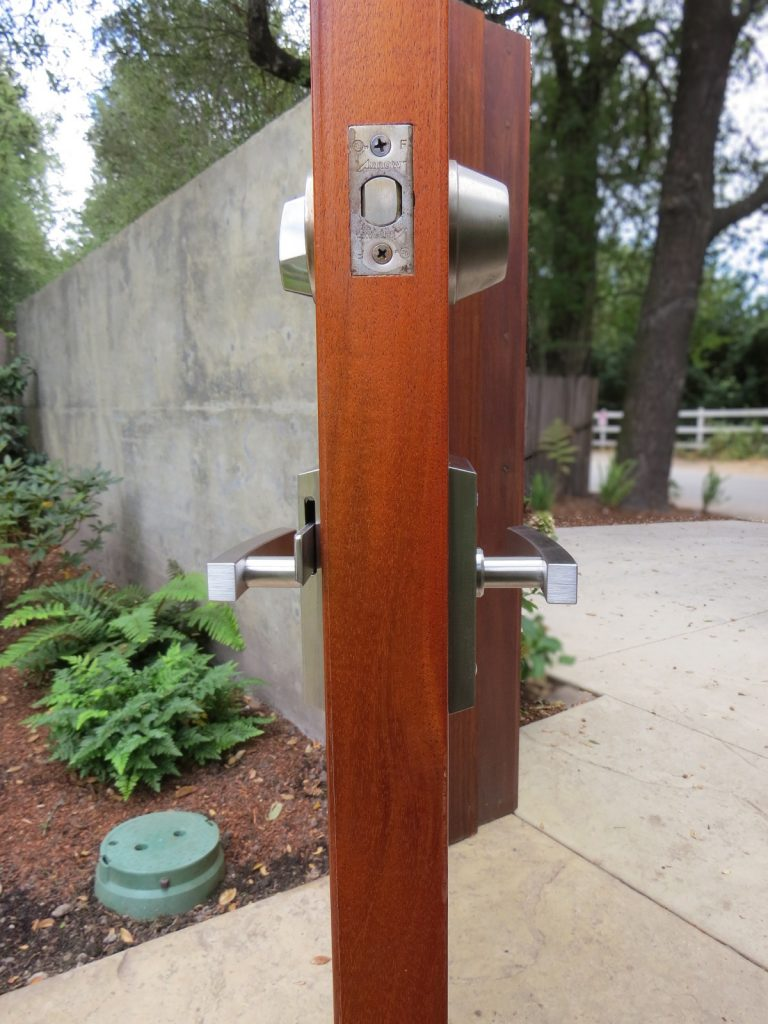 Alta Contemporary Stainless Steel Gate Latch and Deadbolt on Mahogany Gate