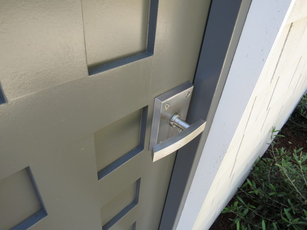 Alta Contemporary Gate Latch in Stainless Steel on Pool House Door